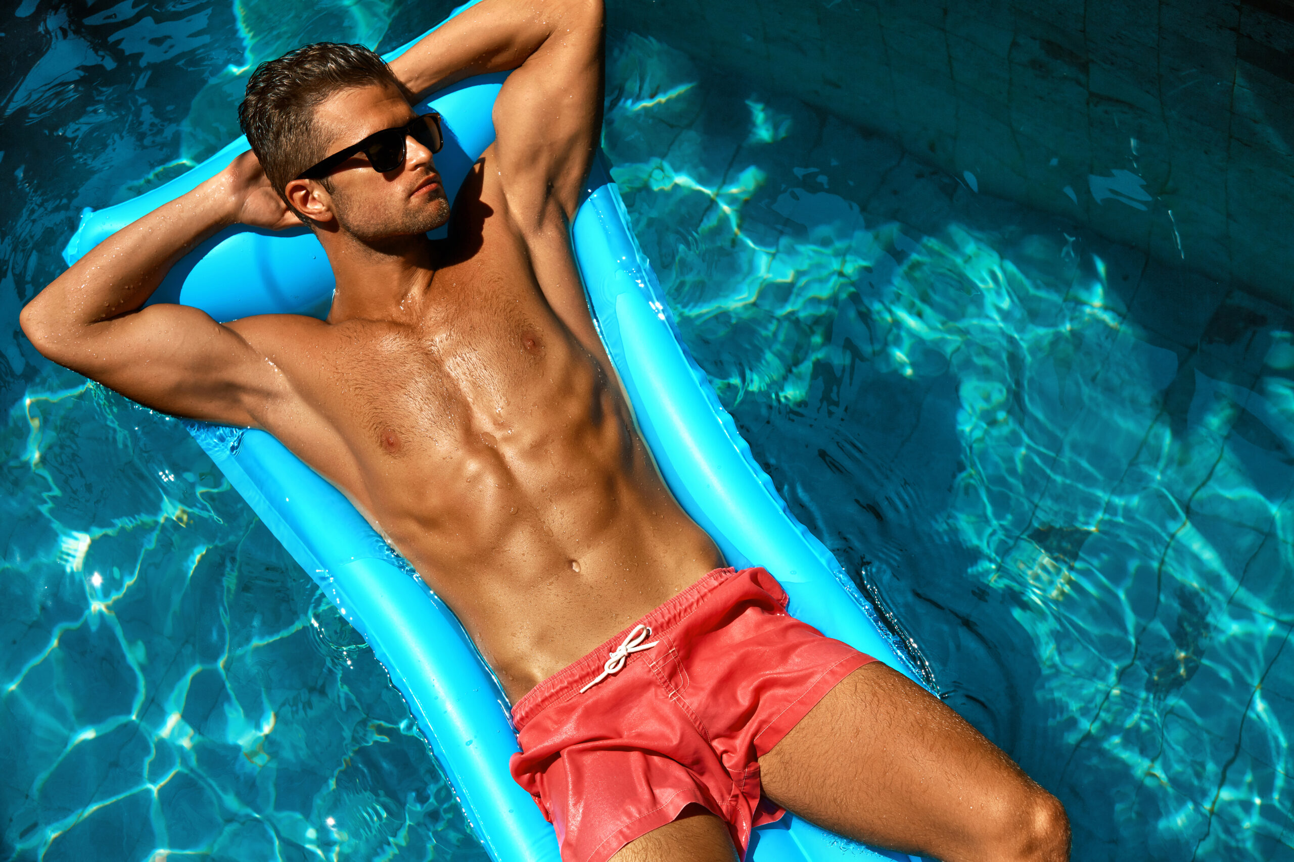 Shirtless man at a Pool